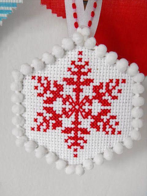 Cross Stitch Christmas Tree Ornaments---cute idea to use small pom poms around edge