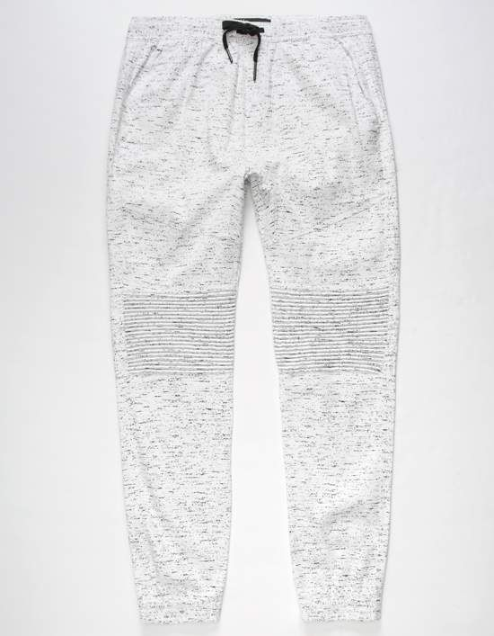 Brooklyn Cloth Space Dye Moto jogger pants. Allover space dye print. Slant front pockets with dual welt back pockets. Drop crotch inset. Moto shirring details at knees. Elastic waistband with drawstring. Elastic cuffs. Approx inseam: 29.5. 98% cotton/2% spandex. Machine wash. Imported.