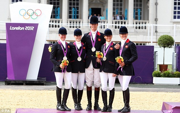 They've done it: Team GB's eventing team won the country's second silver medal of the London Games despite an early mistake by Zara Phillips (centre)
