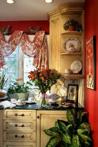 French country inspired... red toile valance, rooster hardware, hand painted trellis backsplash, antiqued cabinets.