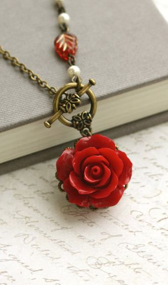 pretty rose necklace. I love that the clasp is next to the pendant--very cute, very unique detail