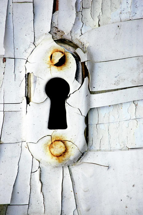 I like the contrast of the rust with the white paint on the keyhole Recommended by London's Locksmith.