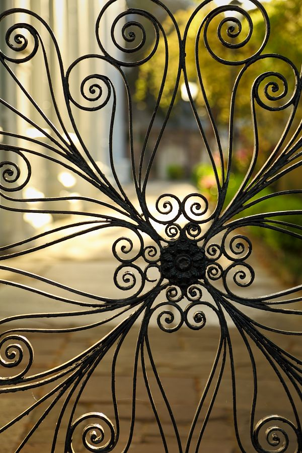 Old Ornate Gate, Saint Michael's Churchyard, Charleston, SC © Doug Hickok: This is a detail of one of the most famous decorative wrought iron works in Charleston, Saint Michael's Churchyard gate. It was made in 1840 by a German born blacksmith,  J. A. W. Iusti. Inside the gate are the tombs of John Rutledge and Charles Cotesworth Pinckney, signers of the U.S. Constitution (1787).