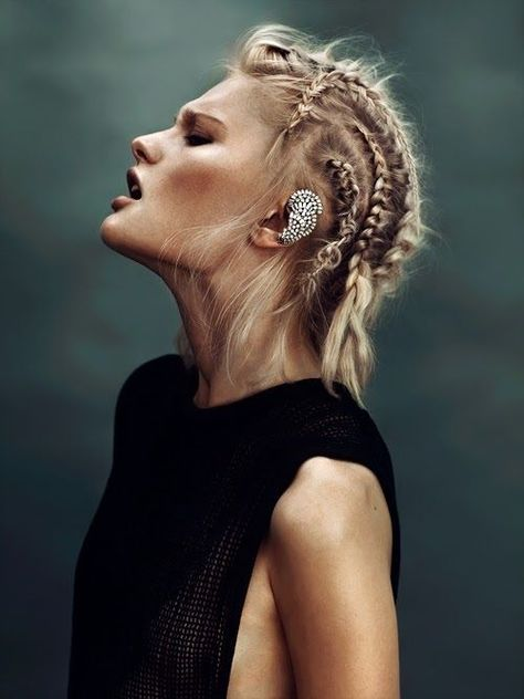 Cornrows and a sculptural ear piece. My love would indulge such folly on a night out to the movies or dinner