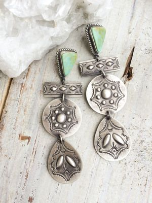 from $270.00 Triangle turquoise earrings with long sterling silver decorative discs. Available in Kingman blue or Gaspeite green.