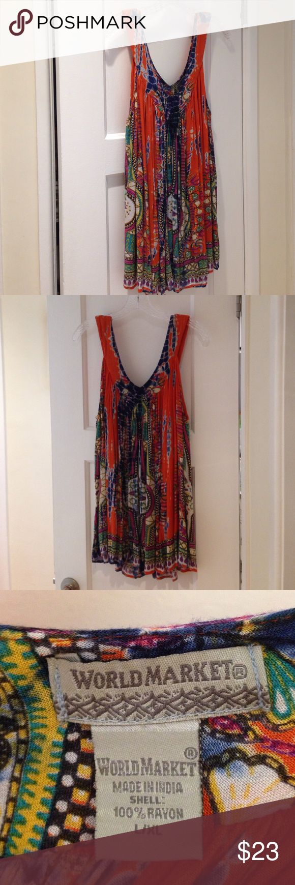 Bohemian Flow Tank Style Woman's Top This World Market bohemian flowy tank style blouse/top has a combined tie dye and Indian pattern that gives it an ethnic look. The flowy style of this top is great for 😉 camouflaging love handles, muffin tops, and or just simply being super comfortable. It's made of 100% rayon, size L/XL. Multicolored in orange, blue, yellow, green, ivory and purple. World Market Tops Tank Tops