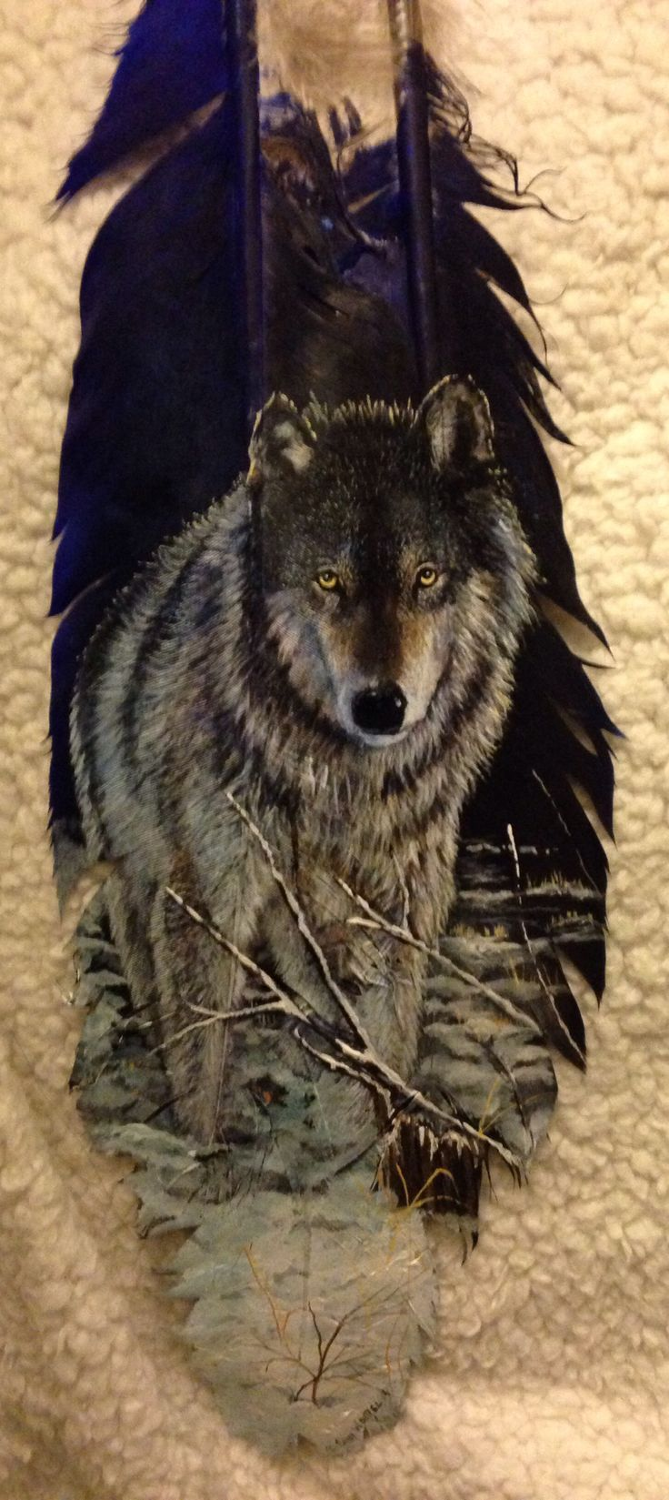 Wolf hand painted feather