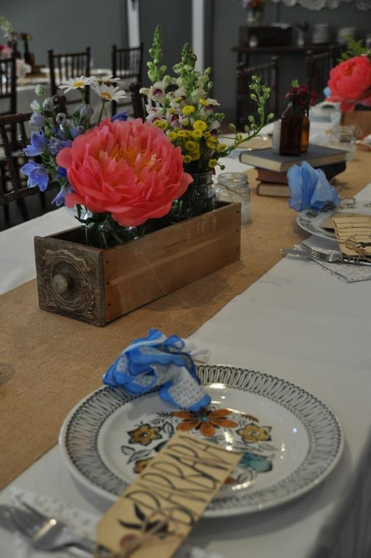Cape Of Love supplied treadle drawers for the flowers.Wood & Belle flowers.  www.capeoflove.com