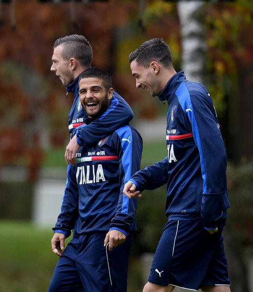 Lorenzo Insigne of Italy (C) smile during the training session at Milanello on November 14, 2016 in Florence, Italy.