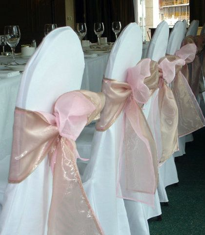 Two sashes tied as one to create a very subtle and elegant color.  Latte with baby pink together create a not so dusty rose effect which looks perfect against crisp white or off white chair covers.  A regular banquet chair cover works best with this look as the simplicity of the chair cover allows the double sash combination to really pop!