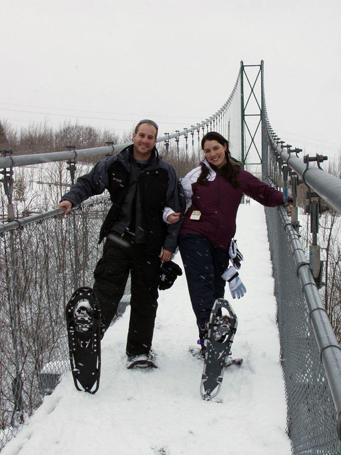 Snowshoeing across the great suspension bridge at Scenic Caves Nordic Center, Ontario