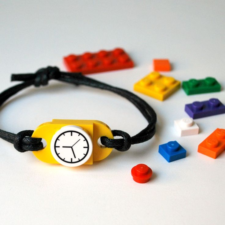 LEGO + jewelry = accessory playtime. This is a bracelet meant to be kept, worn and played with over and over as it is imagined and re-imagined at whim. The bracelet can be endlessly redesigned using the included extra LEGO pieces--out of sheer boredom while riding in the school bus, or just to match that special outfit your kid is wearing today. It can be worn as a faux-watch with the clock-face plate, or can be redesigned in any variety of colorful configurations using various bricks. H...