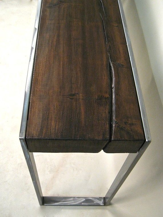 This elegant hall table features a hand scraped Silver Maple top that was reclaimed from Washington Park on the South Side of Chicago after a windstorm swept through the area in 2006. The wood is finished in a dark hand rubbed finish, with a natural lacquer applied. A hand welded, ground and brushed steel frame adds a touch of industrial edge to the rustic finish of the wood. $1750.00