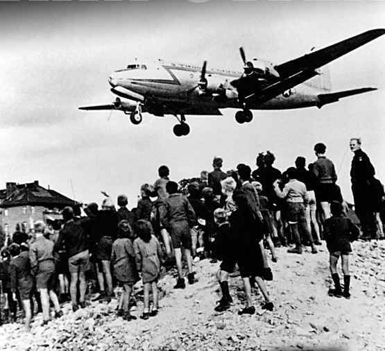 "Gail Halvorsen's candy bombing over Berlin garnered attention in the US, and both the Confectioners Association of America and schoolkids chipped in to get candybars and gum to starving kids in Berlin.  By the end of ""Operation Little Vittles"", Gail had dropped over 23 tons of chocolate & candies to the Berlin kids below."