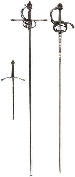 Foiled practice rapier and dagger.  Along side a rapier that is circa 1590.