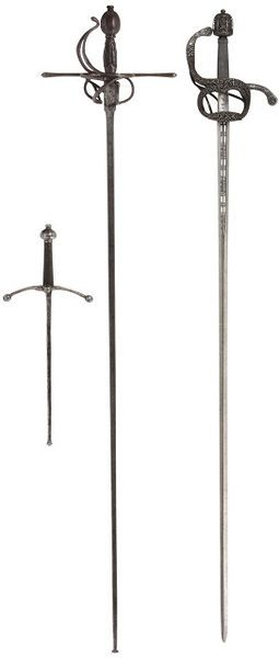 Foiled practice rapier and dagger.  Along side a rapier that is circa 1590.