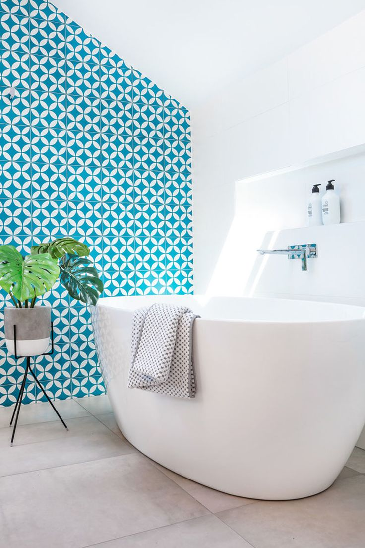 Modern blue and white bathroom - This White And Wood Bathroom Has A Bright Blue Accent Wall To Liven It Up