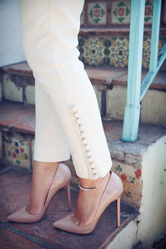 Those pants! Those buttons! Need! Anthropologie white skinny pants. cigarette jeans.