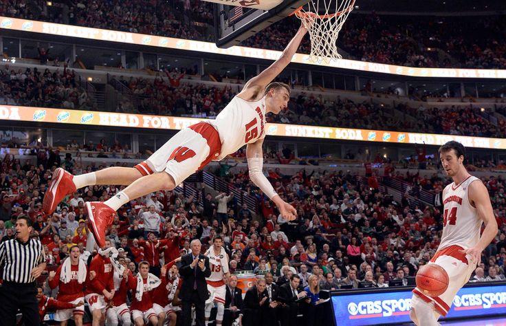 Wisconsin Badgers forward Sam Dekker (15) hangs onto the rim - David Banks/USA TODAY Sports
