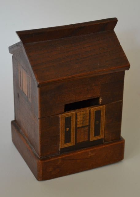 Antiques at York's Tenement. Parquetry House Money Box A little parquetry house money bank wth doors, windows and shutters and brickwork detail. Northern European, various woods, circa 1870 Height: 5 inches Width: 3.5 inches Depth: 3 inches Price: £485 Ref: 2149