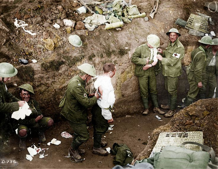 Canadian soldiers receive medical treatment, including a troop on the left with shell shock, after the battle of Courcelette- Courcelette, France 1916