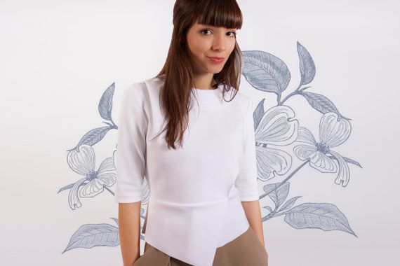Hand made stylish minimal top, perfect for any occasion or a night out with your loved one. This white top has 3/4 sleeves, peplum and asymmetric