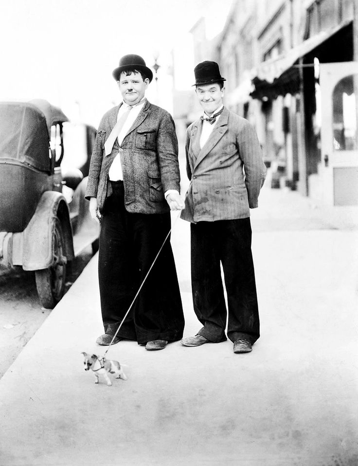 Oliver Hardy and Stan Laurel with tiny dog by  Unknown Artist - 1932