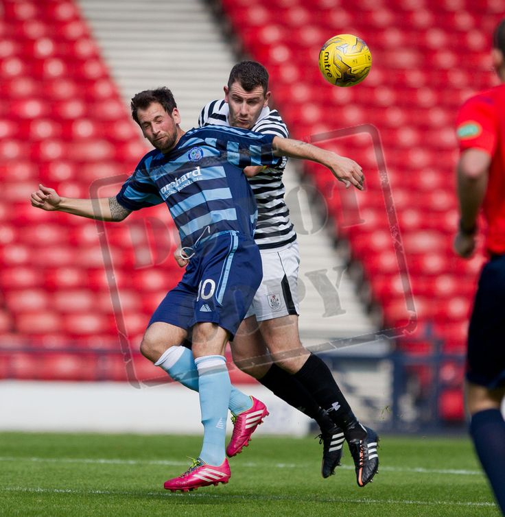 Tony Quinn gets in front of Forfar's Gavin Swankie to head the ball clear.