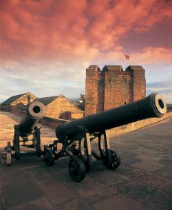 View of Canon at Carlisle Castle with sunset in background, built by the son of William the Conqueror . William II and over 900 hundred years old, Cumbria, UK
