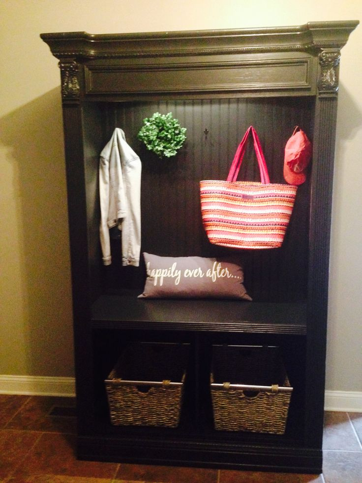 Entertainment center redone to become a mudroom piece.