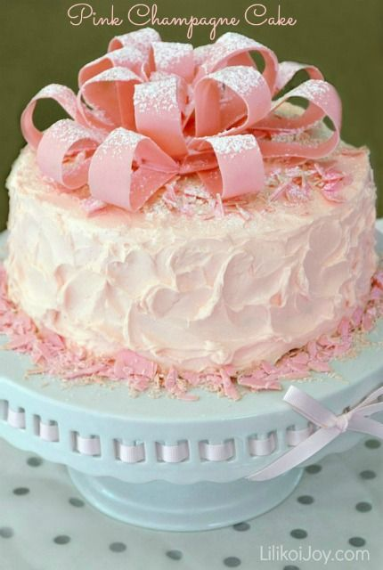 Pink cake with strawberry mousse filling. If the chocolate bow is to is too difficult to make you cake use sour candy stripes from Look-O-Look