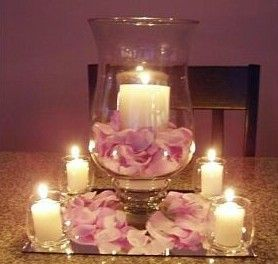 Rose petal and candles centerpiece - The Knot