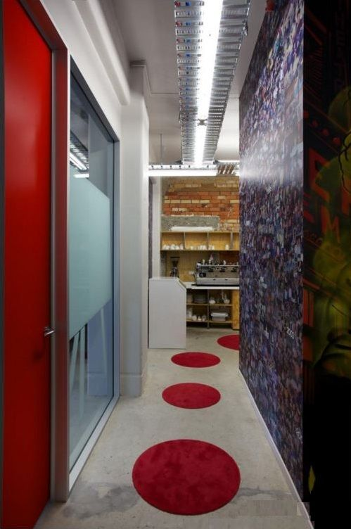 The red carpet appears on the polished concrete floor allow us to introduce more fun in our office and a guide line to our cozy kitchen, also makes a confident combination of viewing by picking the red from board room door.