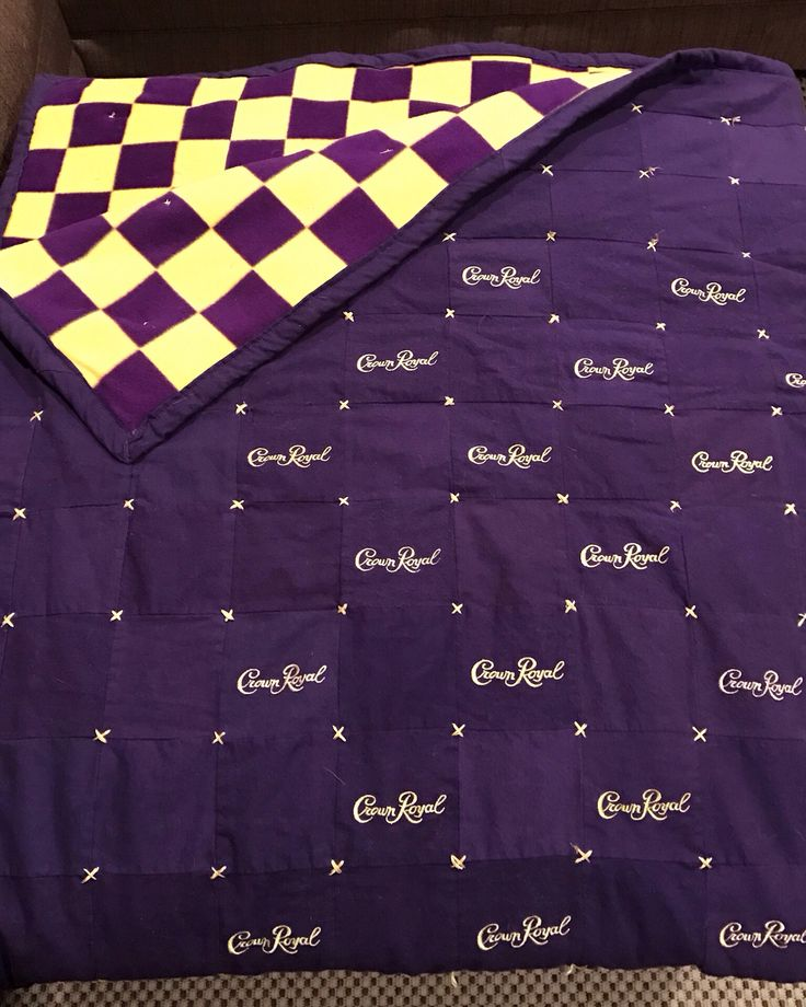 Crown Royal Quilt, gold embroidery thread to make x to tie the quilt.