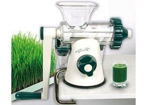 A hand cranked auger juicer that can take leafy greens! And it`s not too expensive either!