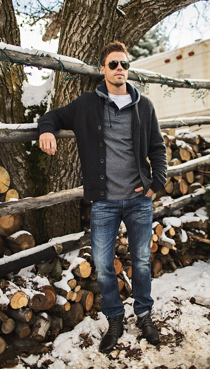 Try teaming a dark grey shawl cardigan with navy jeans to create a great weekend-ready look. Finish off this look with black leather boots.  Shop this look for $138:  http://lookastic.com/men/looks/sunglasses-crew-neck-t-shirt-hoodie-shawl-cardigan-jeans-boots/7625  — Black Sunglasses  — White Crew-neck T-shirt  — Grey Hoodie  — Charcoal Shawl Cardigan  — Navy Jeans  — Black Leather Boots