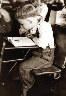 School Boy from 1938.The child looks to be bare footed, which was a common thing during this period, as many people simply could not afford shoes for their children.