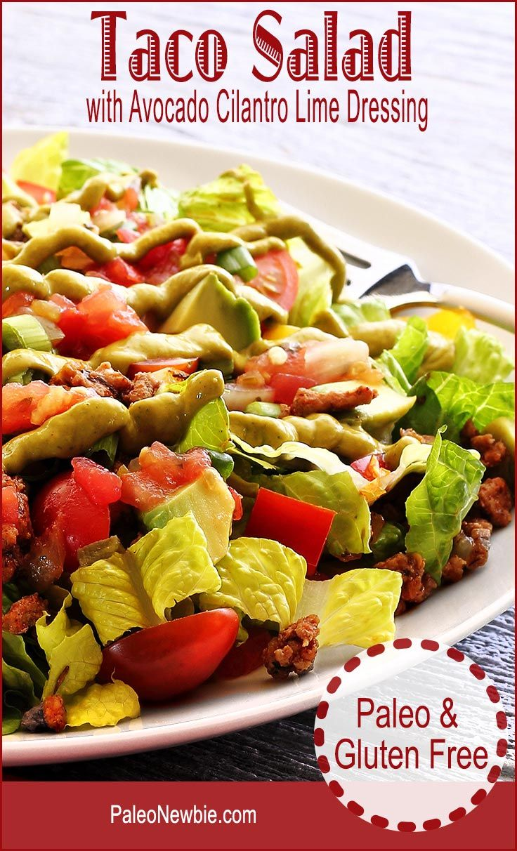 Easy taco salad spiced just right and topped with a fresh avocado-based dressing. Make with ground beef or turkey. Layers of Mexican-inspired flavors in this one! #paleo #glutenfree