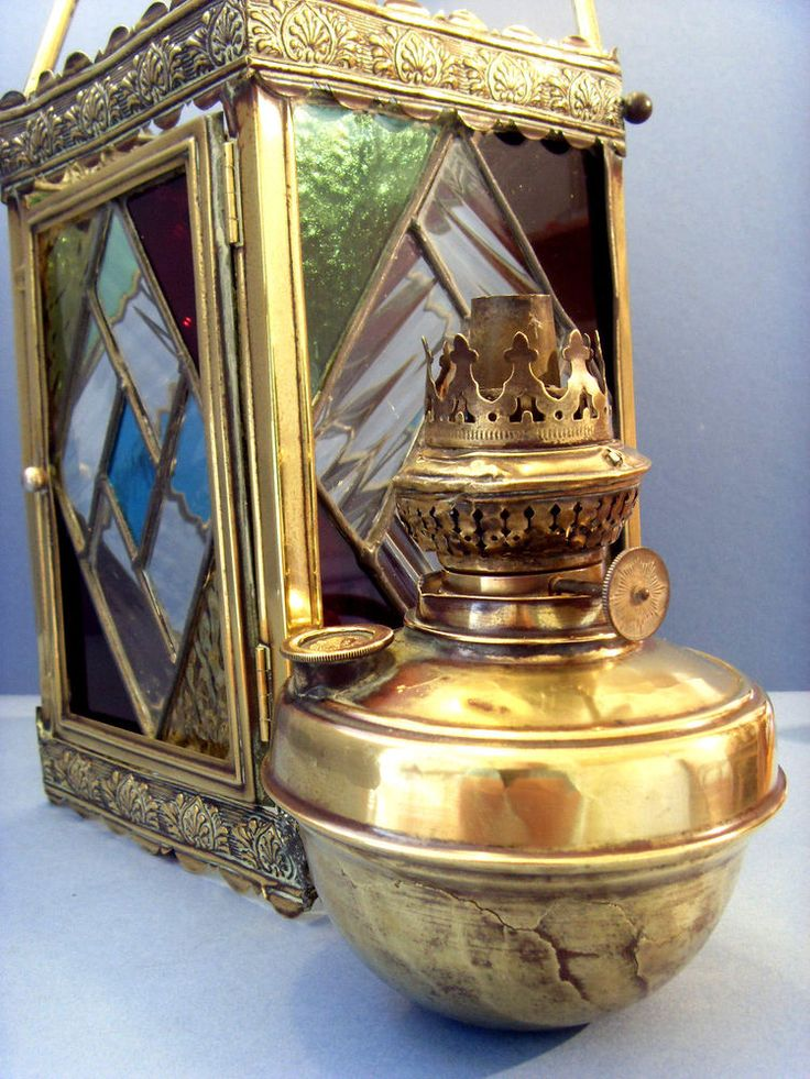 "VICTORIAN STAINED GLASS BRASS LANTERN WITH ITS ""THE WIZARD"" OIL LAMP, c1880."