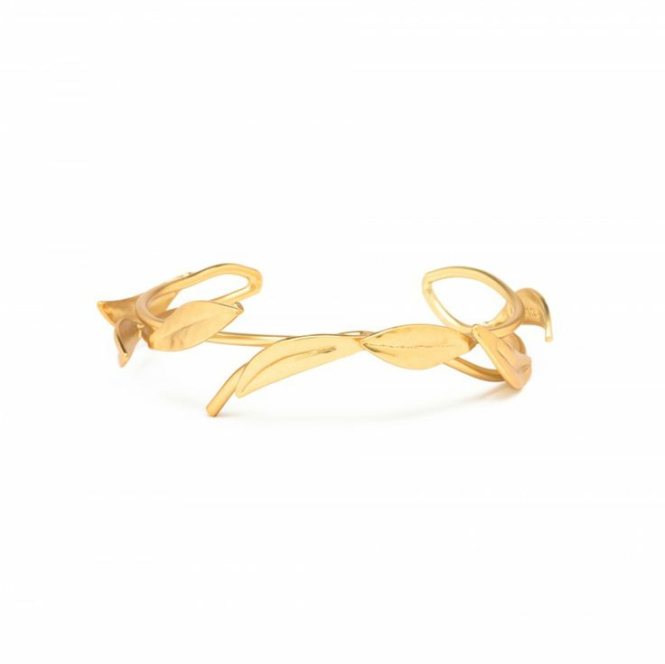 pulsera rigida en metal dorado mate con forma de rama con hojas eclipse collection
