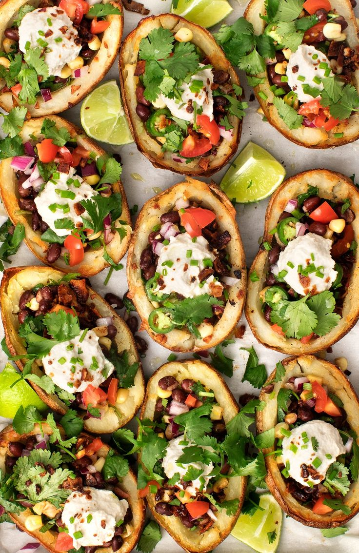 A healthy vegan super bowl party recipe. These potato skins are stuff with black bean salad, sunflower sour cream and coconut bacon. A fun game day snack.