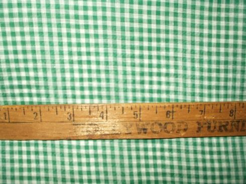 Dating from the Depression era of the 1920's or 1930's, a piece of green and white 100% cotton gingham yardage in unused condition. The yardage is a heavier weight sheer. In other words, a hand held