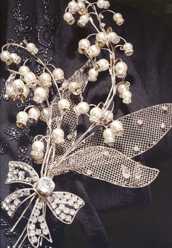 """Brooch in the form of a bouquet of lily of the Valley flowers for the black """"Bar"""" suit from Christian Dior collection of Haute Couture fall-winter 2007-2008."""