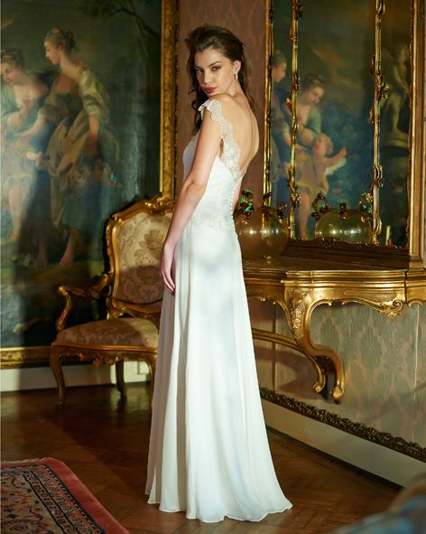 Charie is a subtle a-line gown in crepe satin and silk georgette, with Chantilly lace bodice and shoulders on an illusion neckline, floral embroidered elements on the dropped waist and neckline adds a sense of opulence.