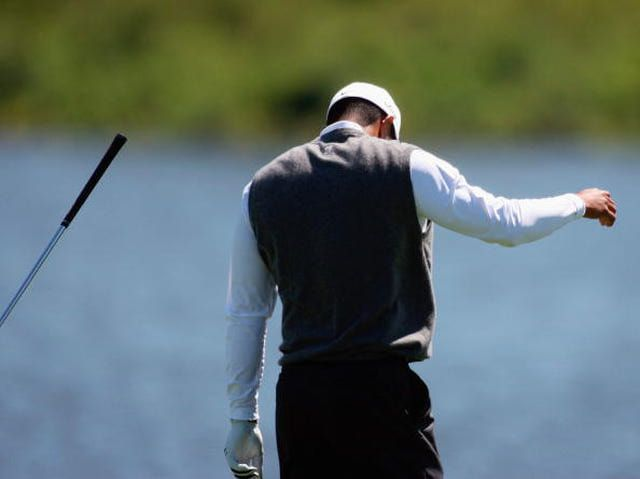 Tiger Woods Pictures: Tiger Woods Throwing Clubs