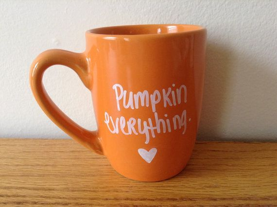 Hand painted orange coffee/tea mug that says pumpkin everything with white writing. Perfect for fall and pumpkin lovers :) this mug is a