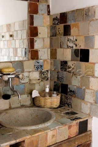 Beautiful ceramic sink and handmade ceramic tiles by Anne Kjaersgaard.