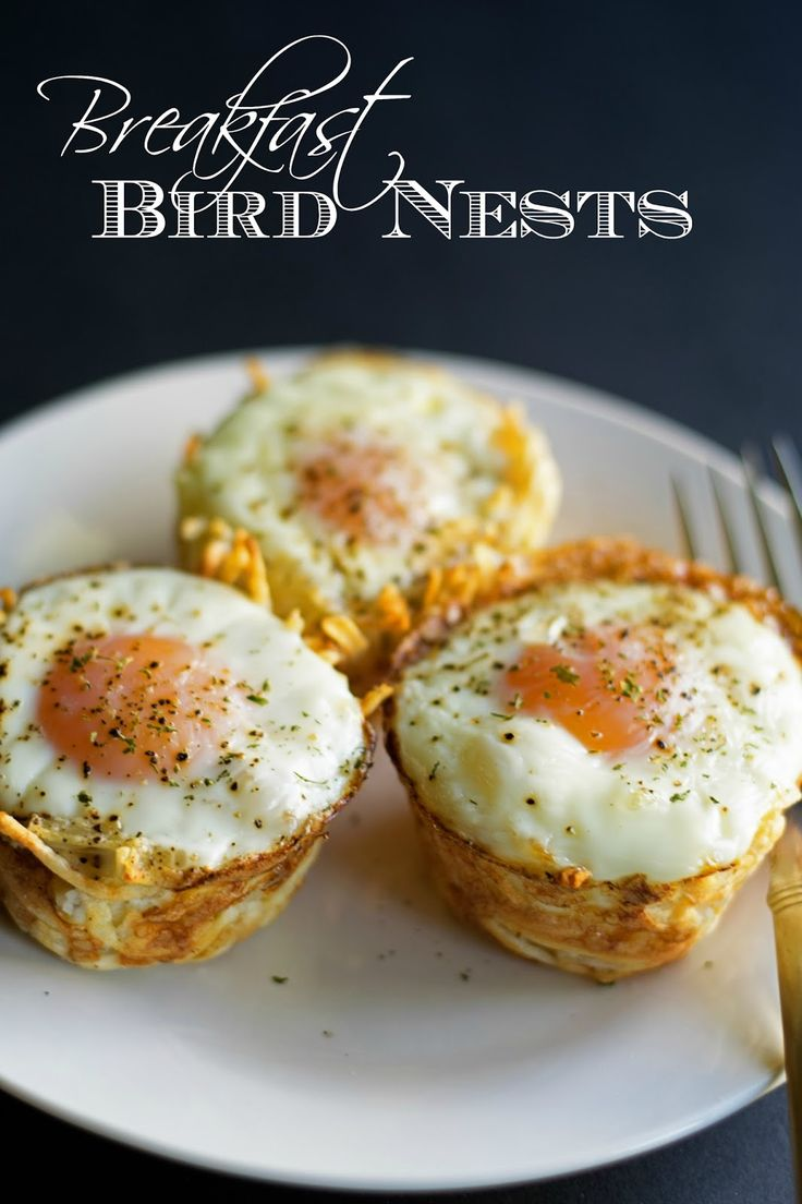Breakfast bird nests made from oven baked toasted hashbrown cups filled he most perfect soft cooked egg.  Perfect finger food idea for a brunch pot luck or serve it up as a breakfast for dinner treat!