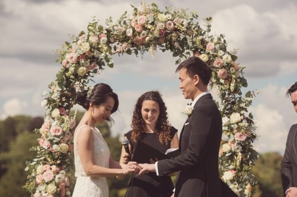 Lucy and George making their vows in front of our floral arch at Chateau Bouffemont Wedding Destination Photographer Rebecca Douglas Photography 0103