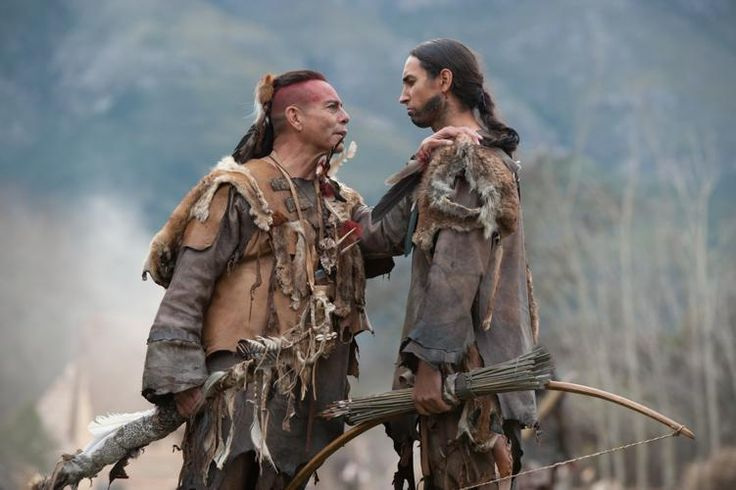 "Raoul Trujillo as Massasoit, left, and Tatanka Means as Hobbamock in National Geographic Channel's two-night movie event ""Saints & Strangers."" (National Geographic Channels/David Bloomer)"